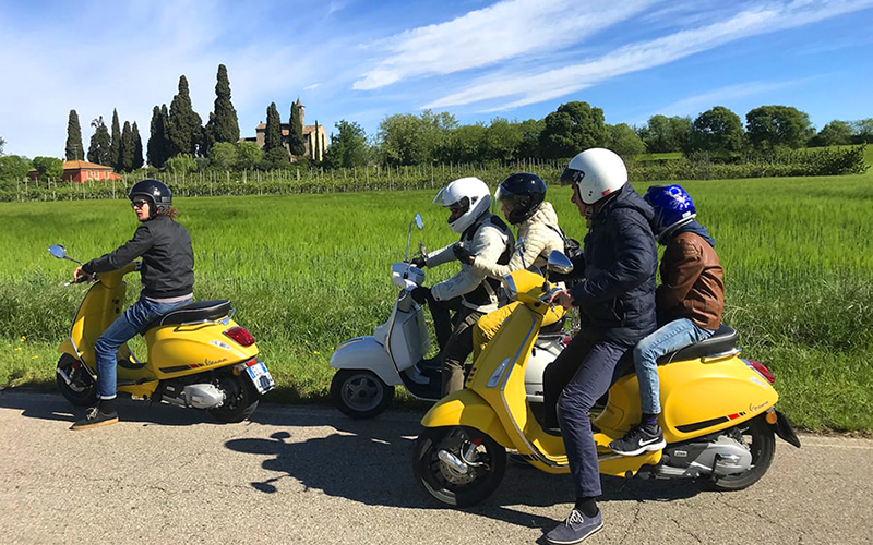 Ride a Vespa through the Morainic hills